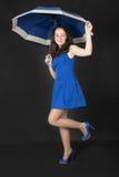 Muchacha con un paraguas Imágenes de archivo libres de regalías