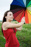 Muchacha con un paraguas colorido Fotos de archivo