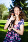 Muchacha con un perro Imagen de archivo libre de regalías