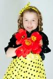 Muchacha con un ramo de tulipanes Fotografía de archivo libre de regalías