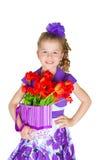 Muchacha con un ramo de tulipanes Imágenes de archivo libres de regalías