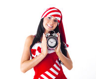 Muchacha con un reloj de alarma Foto de archivo