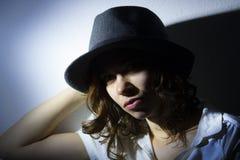 Muchacha con un sombrero Foto de archivo libre de regalías
