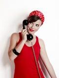 Muchacha con un teléfono de la vendimia Imágenes de archivo libres de regalías