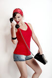 Muchacha con un teléfono de la vendimia Fotos de archivo libres de regalías