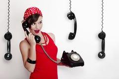Muchacha con un teléfono de la vendimia Foto de archivo libre de regalías