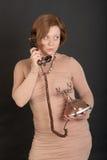 Muchacha con un teléfono retro Foto de archivo libre de regalías