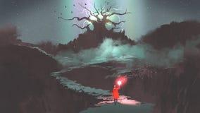 Muchacha con una antorcha mágica que camina al árbol de la fantasía Foto de archivo libre de regalías