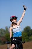 Muchacha con una bicicleta Imagen de archivo libre de regalías
