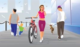 Muchacha con una bicicleta Imágenes de archivo libres de regalías