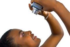 Muchacha con una cámara del snmall Foto de archivo libre de regalías