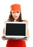 Muchacha con una computadora portátil Fotos de archivo libres de regalías