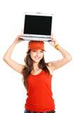 Muchacha con una computadora portátil Imagen de archivo libre de regalías
