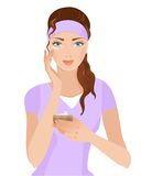 Muchacha con una crema en su cara Imagenes de archivo