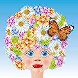 Muchacha con una decoración de colores y de la mariposa. Fotografía de archivo libre de regalías