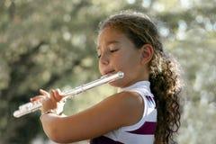 Muchacha con una flauta Fotos de archivo