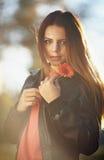 Muchacha con una flor Imagen de archivo