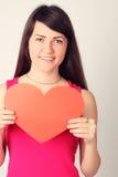 Muchacha con una forma del corazón Foto de archivo libre de regalías