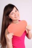 Muchacha con una forma del corazón Fotografía de archivo libre de regalías