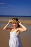 Muchacha con una guirnalda Fotos de archivo