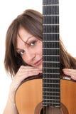 Muchacha con una guitarra Foto de archivo libre de regalías