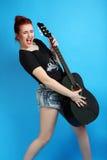 muchacha con una guitarra Imagen de archivo libre de regalías