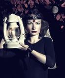 Muchacha con una linterna Foto de archivo libre de regalías