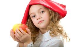 Muchacha con una manzana Fotos de archivo