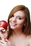 Muchacha con una manzana en su mano Foto de archivo
