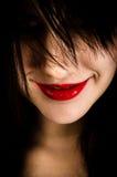 Muchacha con una mueca en su cara Imágenes de archivo libres de regalías