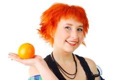 Muchacha con una naranja Fotografía de archivo