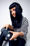 Muchacha con una palanca de mando Fotos de archivo