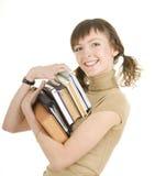 Muchacha con una pila de libros Foto de archivo libre de regalías