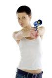 Muchacha con una pistola del juguete Fotografía de archivo