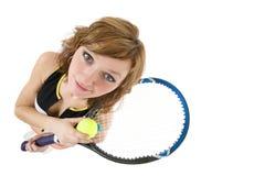 Muchacha con una raqueta de tenis y una bola Imagen de archivo