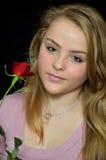 Muchacha con una rosa Imágenes de archivo libres de regalías