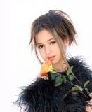 Muchacha con una rosa Imagen de archivo libre de regalías