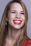 Muchacha con una sonrisa atractiva Fotografía de archivo libre de regalías