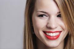 Muchacha con una sonrisa atractiva Fotografía de archivo