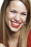 Muchacha con una sonrisa atractiva Imagen de archivo libre de regalías