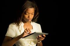 Muchacha con una tableta. Imágenes de archivo libres de regalías