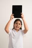 Muchacha con una tableta digital Fotografía de archivo libre de regalías