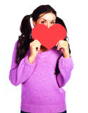 Muchacha con una tarjeta de la tarjeta del día de San Valentín Imagen de archivo