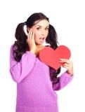 Muchacha con una tarjeta de la tarjeta del día de San Valentín Fotografía de archivo libre de regalías