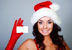 Muchacha con una tarjeta de visita Imagen de archivo