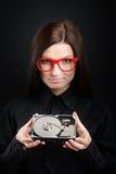 Muchacha con una unidad de disco duro Fotografía de archivo libre de regalías
