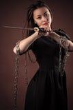 Muchacha coreana brutal con la espada en manos Foto de archivo libre de regalías