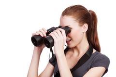 Muchacha curiosa con los prismáticos Fotografía de archivo