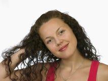 Muchacha dark-haired sonriente en rojo Foto de archivo