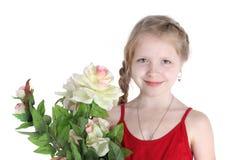 Muchacha de 8 años con las flores Imagen de archivo libre de regalías